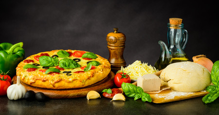 Pizza Margherita with Vegetables, Dough and Cooking Ingredients Stock Photo