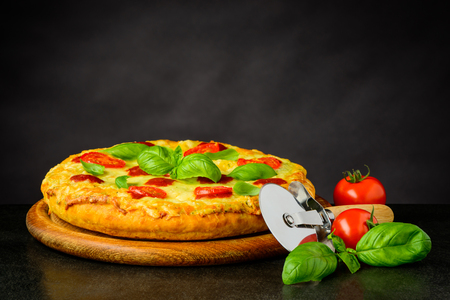 Pizza Margheritta with Pizza-cutter wheel