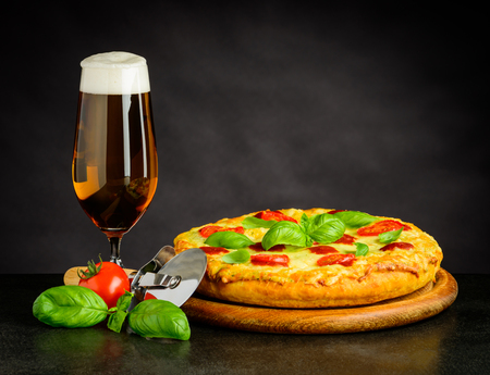 Tasty looking Beer and Pizza Margherita Stock Photo - 77907216
