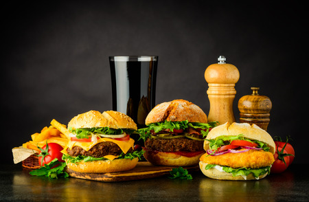 Fast Food with Cheeseburger, burger and Chickenburger and French Fries Stock Photo