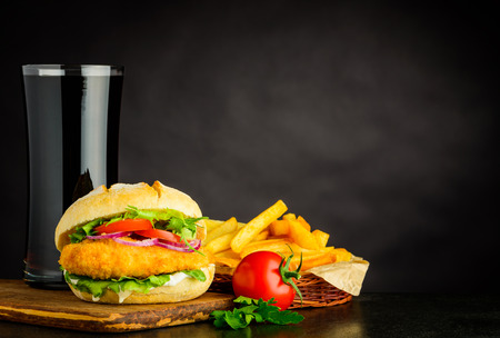 Cola with French Fries and Chickenburger Sandwich on Copy Space Text Area Stock Photo - 79411049