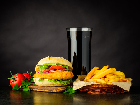 Chickenburger with Cola and French Fries Fast Food on Dark Background Stock Photo - 79452829