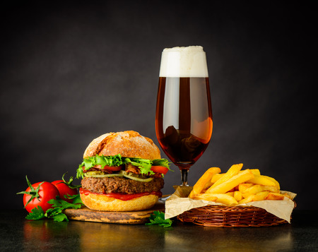 Beer, French Fries and Tasty Looking Burger Fast Food