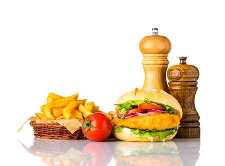 Chickenburger Sandwich with French Fries Fast Food and Condiments on White Background Stock Photo