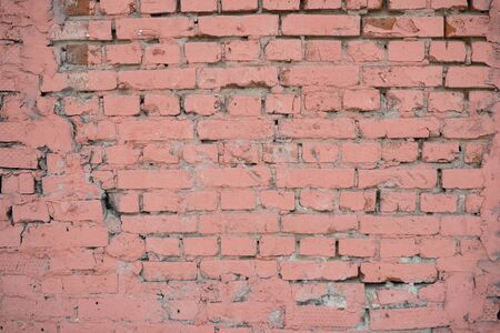 Background image of a painted brick wall. Sloppy brickwork. Detail brickwork texture. Texture for the interior. A wallpaper for the desktop. Text space. Painted in pink. Brick in construction. 版權商用圖片
