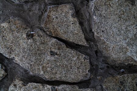 Graphic resources masonry texture of rock stones. Facade of knowledge. The architectural solution is masonry made of granite. A rough, simple wall of an old building. 版權商用圖片