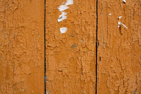 Background image of a wooden fence. Texture of painted wood. The texture of the old paint. Cracks in the paint. Wooden boards. Old fence painted with yolk paint. Text space. Wallpaper. 版權商用圖片