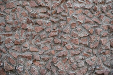 Masonry texture. Background image of granite masonry. Texture for the exterior. Interior decoration at home. Background for text. Space for text. Wallpaper. Macro photo. Detailed texture. Top view.