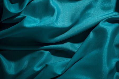Background image of crumpled fabric. Blue silk 免版税图像