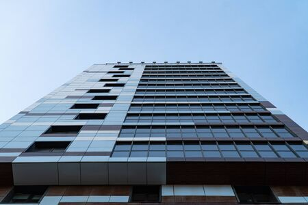 Background image of architectural elements of buildings and structures. Elements and parts of multi-storey offices and shopping centers. The use of reflective glass in construction.