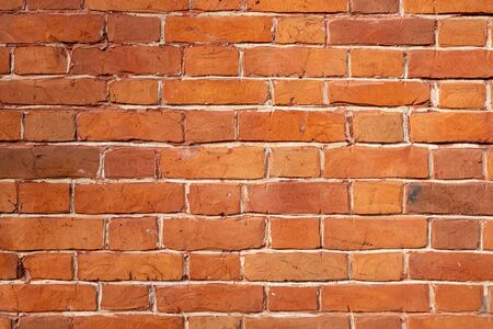 Brick texture. Background image of masonry. Texture for the exterior. Decorative brick. Interior decoration at home. Background for text. Space for text. Wallpaper. Detailed texture. Top view.