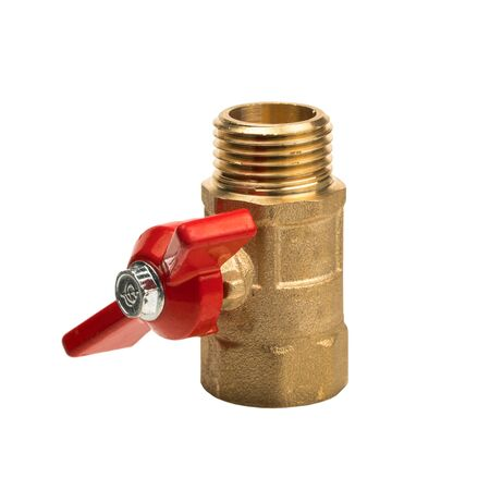 Isolated object on a white background. Water tap with a red valve. Part of the water supply system. Valve used in plumbing. A device in which when turning the flywheel, the fluid passageway is blocked