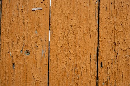 Background image of a wooden fence. Texture of painted wood. The texture of the old paint. Cracks in the paint. Wooden boards. Old fence painted with yolk paint. Text space. Wallpaper. Imagens