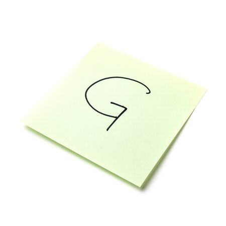 Paper sticker. Stylized image of the letter g. Isolated sticker with shadow on a white background. Sticky note. A piece of paper for notes. Self-adhesive piece of paper. Imagens