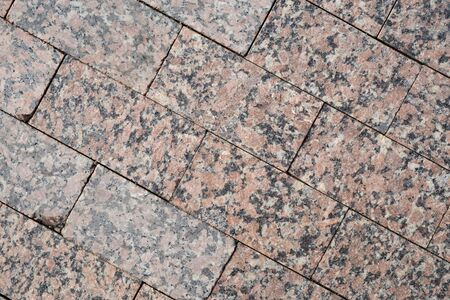Background image of pavement cover. Detailed texture of paving marble tiles. Text space. Wallpaper. Footpath cover. Texture for the exterior. Marble tiles for the pedestrian road. Top view.