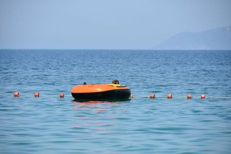 vlora albania august a boy in a colorful inflated trendy floating blue sea