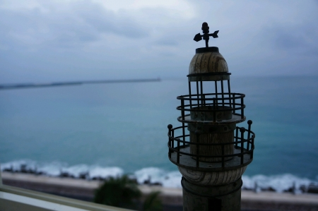 Light tower with selective focus of sea background