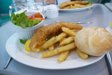Fish and chips with bun and salad