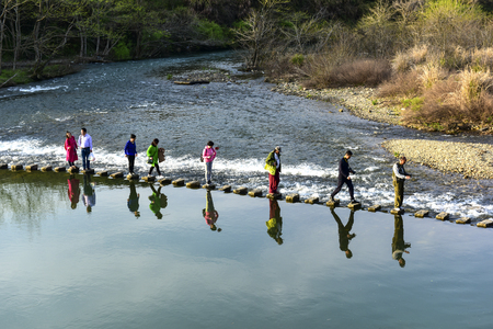 Wuyuan, March 23, 2018: visitors to the rainbow bridge, Jiangxi, China