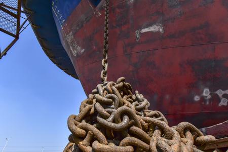 A rusty anchor chain on a ship