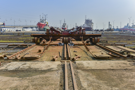 Mechanical equipment and rails used by a shipyard for pulling and repairing ships ashore. Editorial