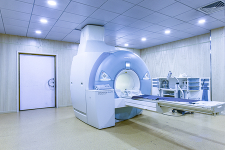 CT (Computed tomography) scanner in hospital laboratory. Health care, medical technology, hi-tech equipment and diagnosis concept with copy space.