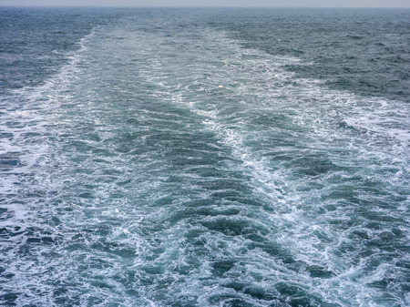 Wind and waves, dark clouds, and boat sights on the sea captured on a cruise ship