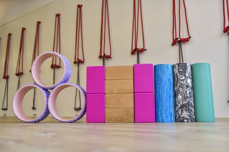 Various yoga props in the yoga studio training room on the wooden floor, props for health activities