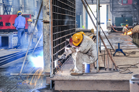 LUANNAN COUNTY, Hebei Province, China - June 20, 2014: workers busy working in steel-making plant workshops. Redakční