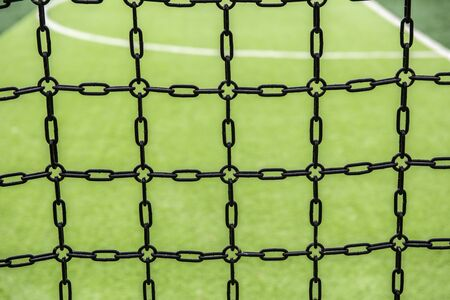 Chain wall background around the playground Stockfoto