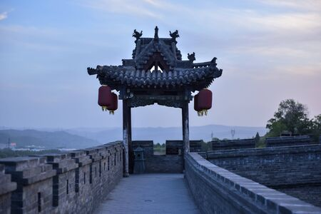 Chinese ancient buildings in the setting sun