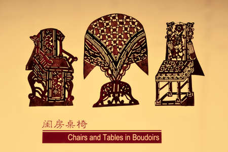 Tangshan City, Hebei Province, China - November 16, 2018: the shadow puppet props of ancient Chinese drama preserved in the museum are translucent crafts carved with donkey skin.