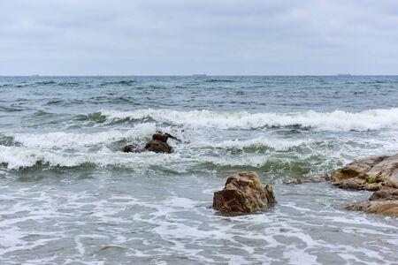 Coastline in the background of dark clouds