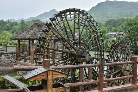 Waterwheel used in ancient town Фото со стока