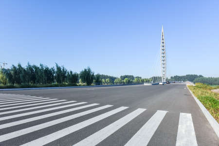 Asphalt roads and Bridges, sidewalks, and skylines against a backdrop of blue sky