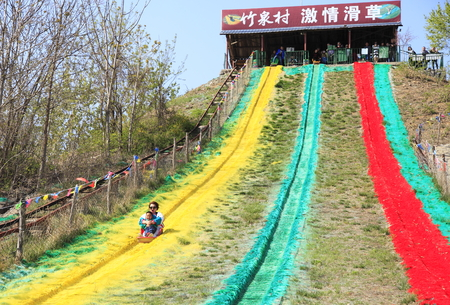 Recreational activity with sliding Grass