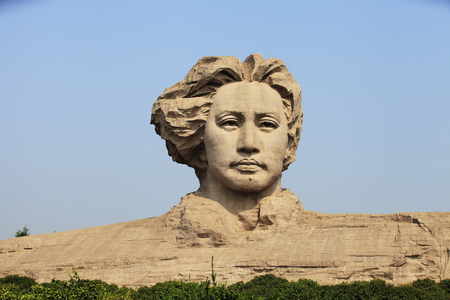 young Mao Zedongs statue Editorial