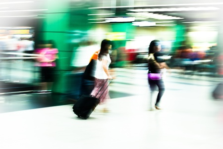 city people: Busy city people walking in subway station in motion blur
