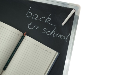 Notebook and little blackboard,the words 'Back to School' written in chalk on the blackboard. Stock Photo - 14967828