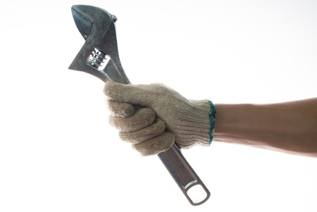 spaner: hand holding an adjustable wrench