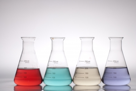 color theory: glass laboratory apparatus with color water Stock Photo