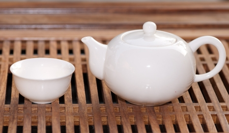tea cups with teapot in teaboard Stock Photo