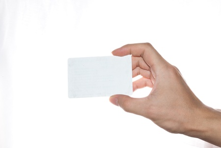 blankness: Hand holding an empty business card on white background