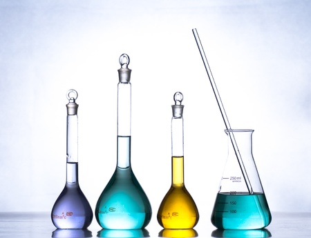 glass laboratory apparatus with color water photo