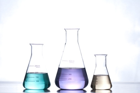yellow lab: glass laboratory apparatus with color water Stock Photo