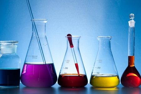 green chemistry: glass laboratory apparatus with color water Stock Photo