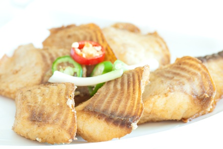 The roasted fillet of tilapia served with capsicum