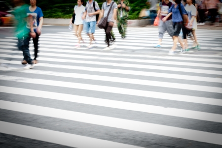 Busy city street people on zebra crossing photo