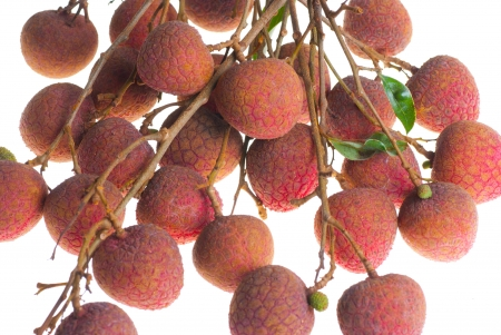 litschi: Some lychee isolated on white Stock Photo