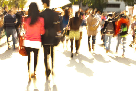 city people: city people walking on piazza in motion blur Stock Photo